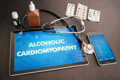 Alcoholic cardiomyopathy (heart disorder) diagnosis medical concept on tablet screen with stethoscope.  royalty free stock image