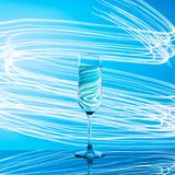 Glass of champagne on neon background. royalty free stock photos