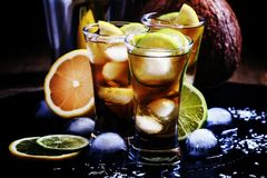 Alcoholic cocktail coconut cola, liqueur, lime, lemon and ice, b Royalty Free Stock Photos