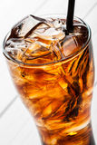 Alcoholic cocktail with cola and ice in a glass Stock Images