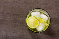 Alcoholic cocktail with green lemon and ice closeup Royalty Free Stock Image