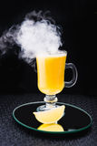 Alcoholic cocktail with lemon and fume Royalty Free Stock Photo
