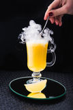 Alcoholic cocktail with lemon and fume Stock Photo