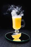 Alcoholic cocktail with lemon and fume Royalty Free Stock Images
