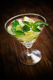 Alcoholic cocktail with mint and lemon Royalty Free Stock Photos