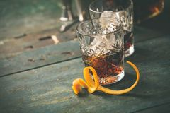 Alcoholic cocktail  with orange peel and ice Royalty Free Stock Images