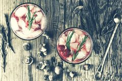 Alcoholic Cocktail, rosemary, Fruity cocktail, raspberry, strawb. Alcoholic Cocktail. Fruity cocktail drink with the addition of alcohol is decorated with frozen Stock Photo