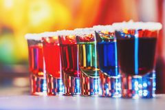 Alcoholic cocktail row on bar counter, colorful shooters cocktails drinks. Cocktail royalty free stock photos