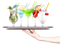 Alcoholic cocktail set on a tray with hand Royalty Free Stock Images
