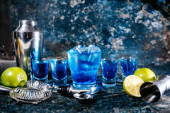 Alcoholic cocktails and garnish served at bar. Alcoholic cocktails and garnish served cold at bar Royalty Free Stock Image