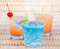 Alcoholic Cocktails. Three drinks beverages Blue lagoon tropical Stock Image