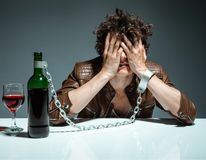 Alcoholic in despair. Photo of youth addicted to alcohol, alcoholism concept, social problem Royalty Free Stock Image