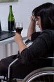 Alcoholic, disabled woman Royalty Free Stock Photography