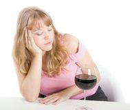 Alcoholic dream of the young woman Royalty Free Stock Images