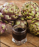 Alcoholic drink with artichoke extract. Royalty Free Stock Photography