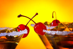 Alcoholic drink with cherries Royalty Free Stock Images