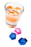 Alcoholic drink and colorful ice cubes Royalty Free Stock Photography
