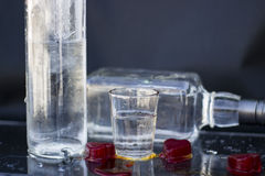 Alcoholic drink. Vodka bottle with glasses and a red ice, vodka and whiskey in glass with ice, alcoholic drink Royalty Free Stock Photos