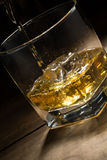 Alcoholic drink on wood table Stock Images
