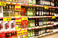 Alcoholic drinks. Liquor shelf in store, full of different alcoholic drinks. Supermarket in Bucharest - Romania royalty free stock photo