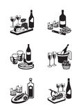 Alcoholic drinks with appetizers Stock Images