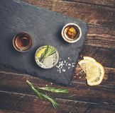 Alcoholic drinks on slate board on rustic wood background. Alcoholic drinks on black slate board on rustic wood background stock photos