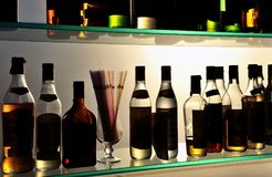 Alcoholic drinks bottles at the pub Stock Images