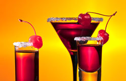 Alcoholic drinks with cherries Royalty Free Stock Image
