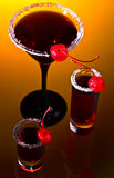 Alcoholic drinks with cherry Royalty Free Stock Photos