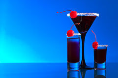 Alcoholic drinks with  cherry Stock Images