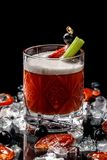 Alcoholic drinks and cocktails for bars and restaurants with ice on a black background in glass glasses. For the menu stock images