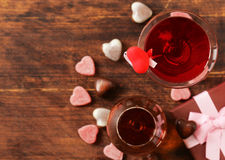 Alcoholic drinks for the festive party. Chocolate candy hearts. Date on Valentines Day Royalty Free Stock Photo