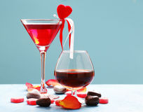 Alcoholic drinks for the festive party. Chocolate candy hearts. Date on Valentines Day Stock Image