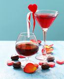 Alcoholic drinks for the festive party. Chocolate candy hearts. Date on Valentines Day Royalty Free Stock Images