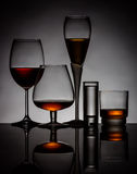 Alcoholic drinks in glasses royalty free stock photos