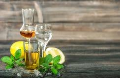 Alcoholic drinks ice lemon mint leaves whiskey gin rum vodka stock photos