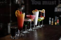 Alcoholic Drinks lined on a bar royalty free stock photos