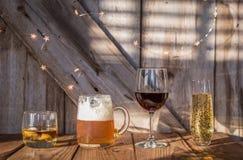 Alcoholic drinks on old weathered wood background royalty free stock image