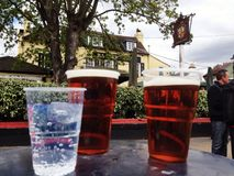 Alcoholic Drinks outside The Barmy Arms Twickenham Royalty Free Stock Photos