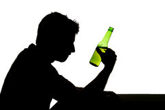 Alcoholic drunk man with beer bottle in alcohol addiction silhouette Royalty Free Stock Photography