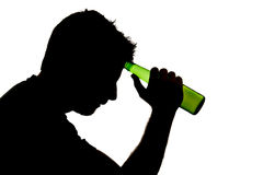 Alcoholic drunk man with beer bottle in alcohol addiction silhouette Stock Images