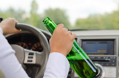 Alcoholic female driving a car Royalty Free Stock Images