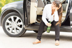 Alcoholic female enjoying a lonely drink Royalty Free Stock Images