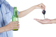 Alcoholic giving a car key to someone. For driving the car Royalty Free Stock Photography