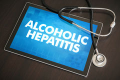 Alcoholic hepatitis (liver disease) diagnosis medical concept on. Tablet screen with stethoscope royalty free stock photo