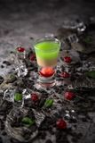 Alcoholic Hiroshima cocktail in shot glass. Cool drink from strong absinthe, whiskey and sweet liqueurs. stock photos