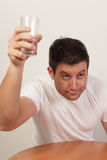 Alcoholic holding up his glass Stock Images
