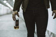 Alcoholic Homeless Holding Liquor Bottle Stock Photo