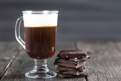 Alcoholic irish coffee with dark chocolate Stock Images