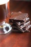 Alcoholic irish coffee with dark chocolate Royalty Free Stock Images
